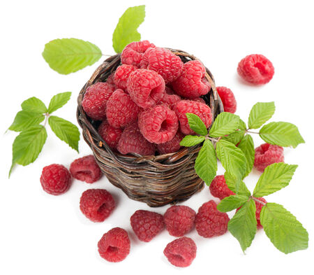 Top view of raspberries with leaves  in little  basket photo