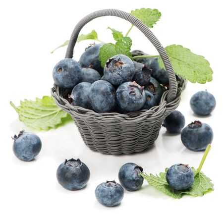 Sweet  blueberries  in basket isolated on white background  photo
