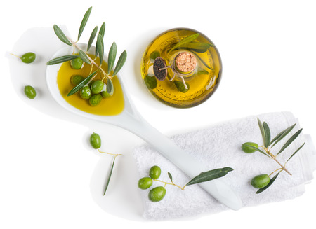 aromatherapy oils: Natural spa setting with olives and olive oil, top view on white Stock Photo
