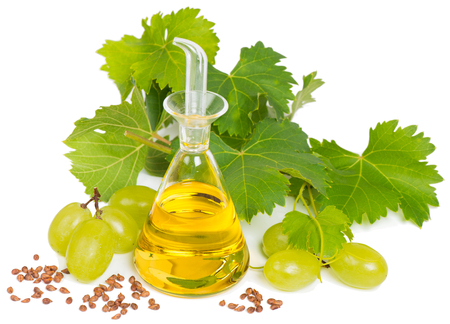 grapes,  seeds and grape seed oil, isolated on white  Stockfoto