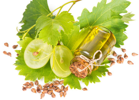 grape seed and grape oil isolated on white