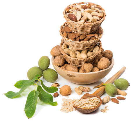 pine nuts: Varieties of nuts: peanuts, almonds, walnuts, pine nuts, brazil.   Isolated  white background,