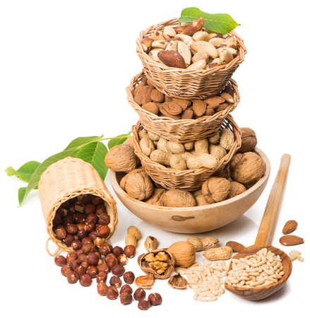 Assorted nuts in baskets  isolated over white photo
