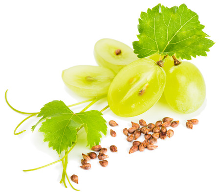 Grapes, grape seeds and vine isolated on white. Selective focus on a seeds.