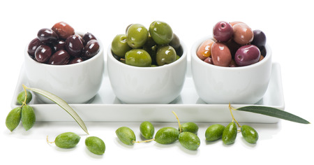 assortment of pickled olives in small individual dishes for snacks,  isolated on white photo