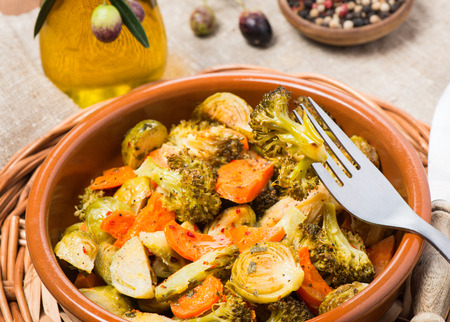 ovenbaked: Oven-baked vegetable (brussels sprouts, carrots, broccoli) in a ceramic bowl served with olive oil and spices