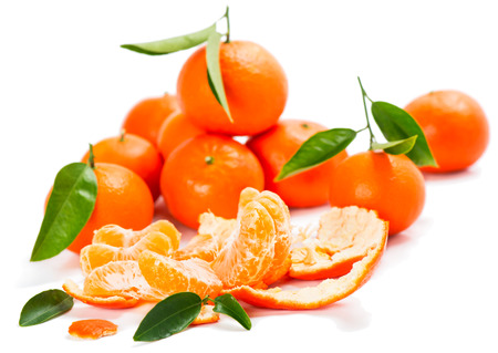 tangerine or mandarin fruit with slices isolated on white background,  selective focus photo