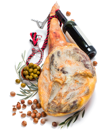 aperitive: Jamon serrano, pickled olives, wine and nuts isolated on a white background.