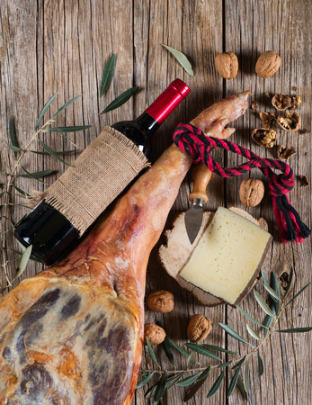 aperitive: Ham leg and traditional spanish tapas  on a wooden background, top view
