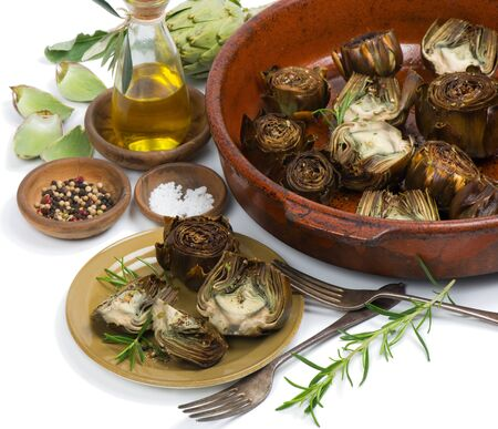 Artichokes served with olive oil, pepper and salt isolated on white photo