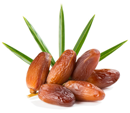 Dried dates on stalk with green leaves isolated on white background