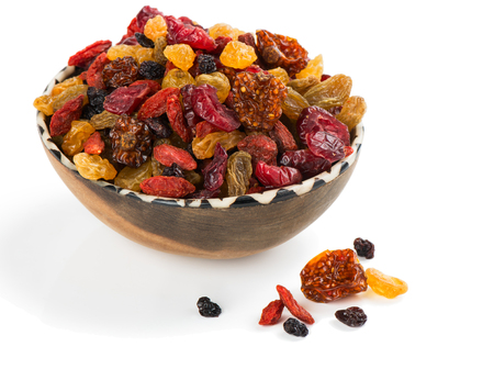 alkekengi: Mix of dried physalis, blackcurrants, blueberries, cranberries, raisins and goji berries in a bowl isolated  a on white background Stock Photo