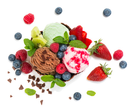 vanilla ice cream: Top view of different varieties ice cream with fresh berries  decorated wit chocolate chips, mint and sauce, isolated on white