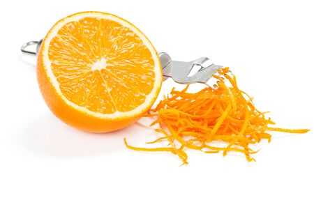 Orange zest, fruit, with zester isolated on a white background.