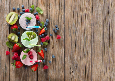 Different smoothies of berry on a wooden old background with space for text, top view Stock Photo