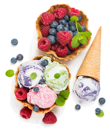 Ice cream of berry in a basket and cone of waffle isolated on white background, shot from above