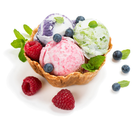 Ice cream of berry in a basket of waffle isolated on white background