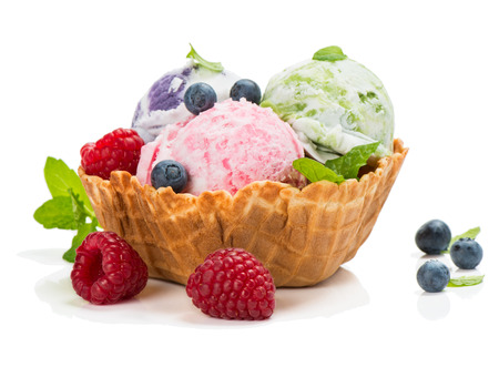 Ice cream in a wafer bowl  and fresh  blueberry and raspberry isolated on white background Standard-Bild