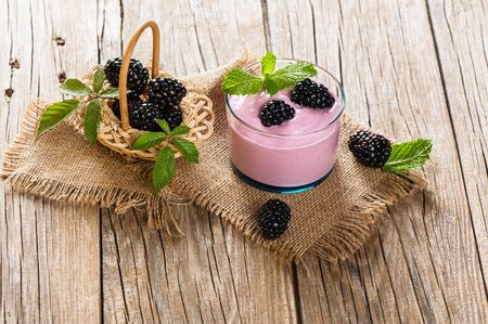 bramble: Bramble smoothie with berries on a rustic wooden table Stock Photo