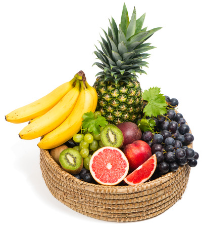 Tropical fruits in a basket isolated on white background.