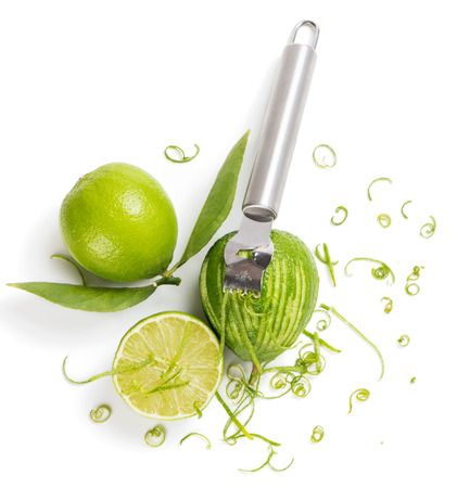 Top view of lime with leaves, lime zest with zester isolated on a white background. Stok Fotoğraf