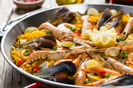 Closeup of spanish paella with shrimp and mussel in a pan. Selective focus. Small deep of focus. Reklamní fotografie - 41214317