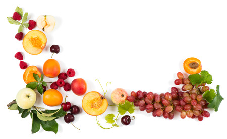 mix fruit: Heap multi-coloured fruits and berries, top view,  isolated on white background