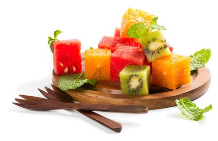 seedless: Fruit salad with watermelon, oranges and kiwi isolated on white background Stock Photo