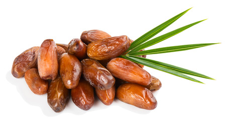 green dates: Dried dates with green leaf isolated on white background