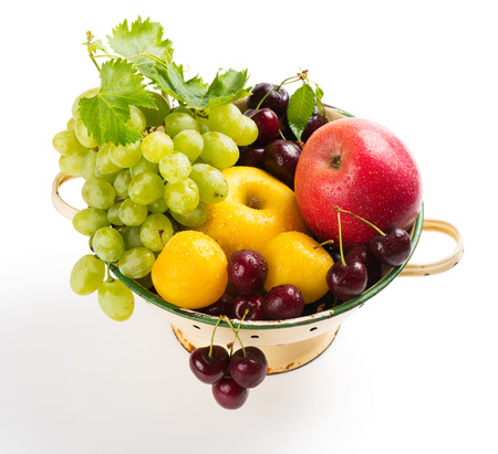 white grape: Bowl vintage colander full of fresh delicious fruits  isolated on white background