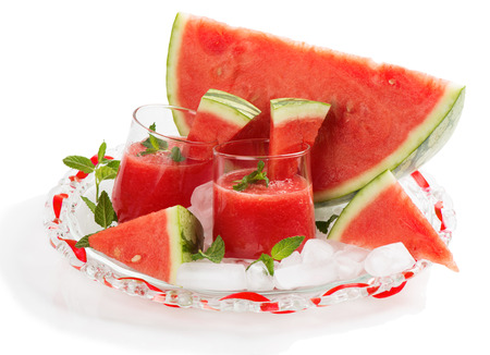 seedless: Glasses of fresh watermelon juice with mint leaves and ice isolated on white background