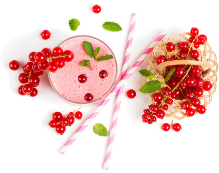 the basket: Top view of red currant milkshake with berries in a basket isolated on white background Stock Photo