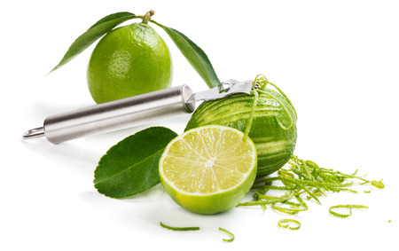 scraping: Scraping zest from an lime isolated a white background