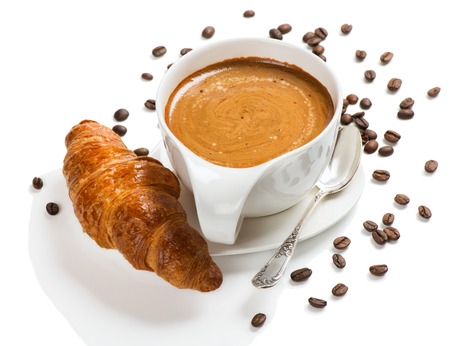 cappuccino: Coffee and croissant with coffee bean isolated on white background.