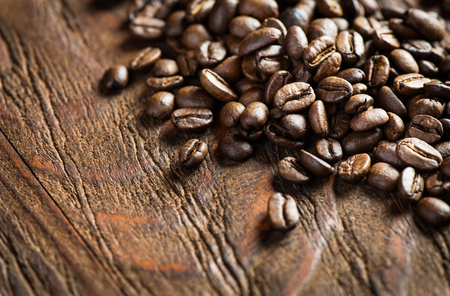 coffee beans: Coffee on wooden background
