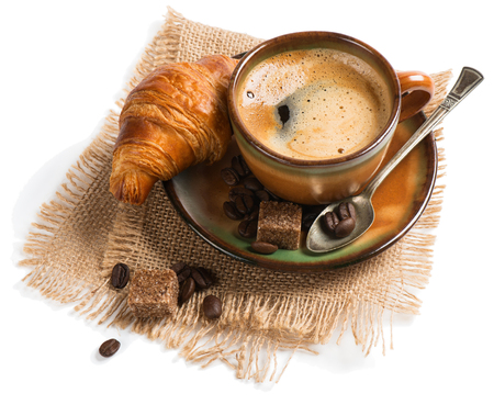 sackcloth: Cup of espresso with cane sugar cubes and  croissant on burlap napkin, isolated on white. Stock Photo