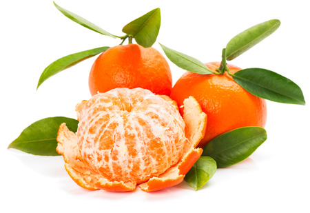 clementine fruit: Peeled and unpeeled tangerine or mandarin fruit with leaves isolated on white background
