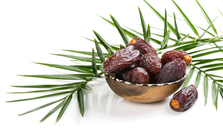 date palm tree: Medjool dried date palm fruits and branch of palm tree isolated on a white background. Stock Photo