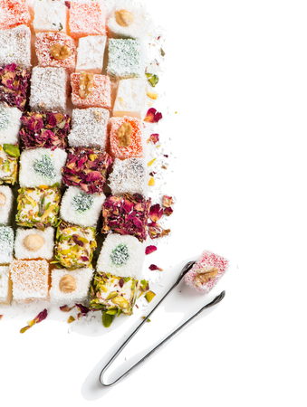 delight: Top view of tasty oriental sweets (Turkish delight lokum) with powdered sugar.  Isolated on white background. Stock Photo