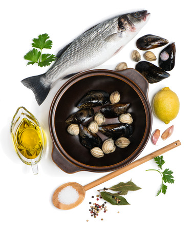cooking oil: Raw fish, different clams and fresh ingredients for cooking, isolated on white background, top view.