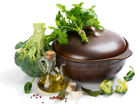 cooking oil: Ingredients for vegetable (vegetarian) soup of broccoli and cooking pot isolated on white background Stock Photo