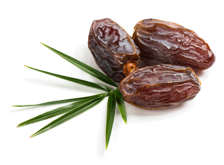 three palm trees: Three medjool big date fruits with green leaf isolated on white background