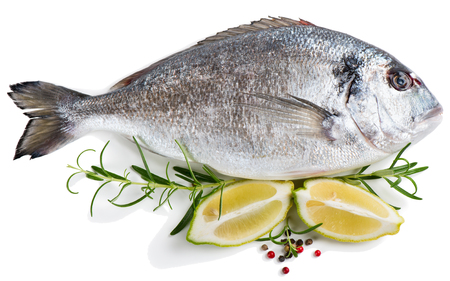 dorada: Fresh dorada fish decorated with lemon, peppers and rosemary isolated over the white background Stock Photo