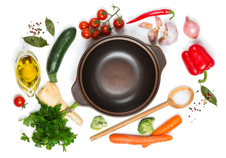 spice: Top view of open pan, fresh raw vegetable and spices for soup isolated on white background