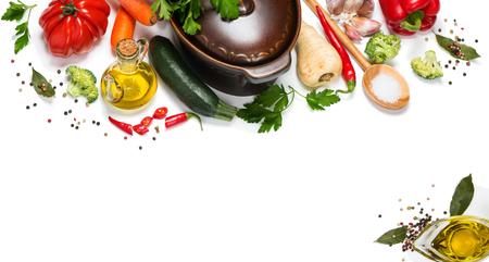 vegetables on white: Fresh vegetables around pan for vegetarian dinner isolated on white background Stock Photo