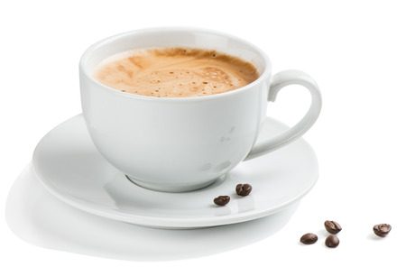 Coffee in a white cup and beans isolated on a white background.