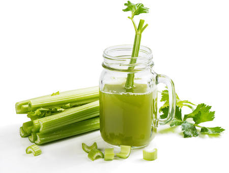 Jar mug  of celery juice and stalks isolated on white