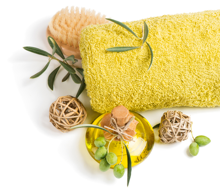 Top view of aroma olive oil, towel and scrub brush isolated on a white background.