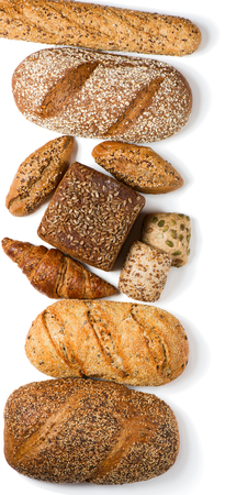 Top view of different kinds of bread with cereals isolated on white background