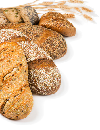 organic flax seed: Composition with cereal bread, rolls and ears of wheat isolated on a white background.